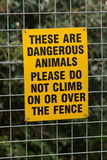 warning sign on fence