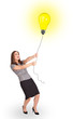 Happy woman holding a light bulb balloon