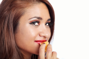 Woman Eating an Orange Wedge