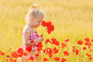 Beautiful little girl with a bouquet of red flowers