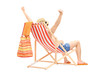 Happy guy enjoying on a beach chair with raised hands