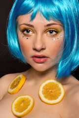 Woman in a blue wig with lemons