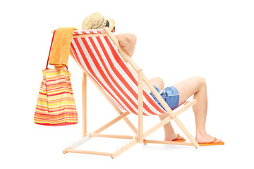 Young man enjoying on a beach chair