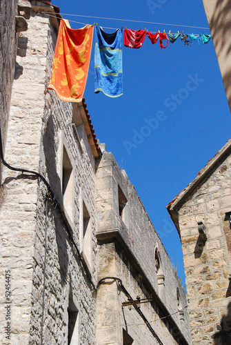 Towels and bathing suits drying up in the old town of Trogir