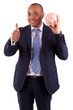 African American business man holding a piggy bank making thumbs