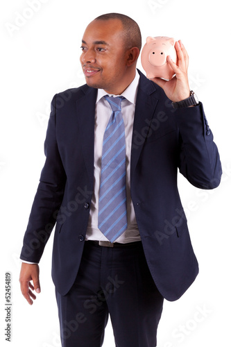 African American business man holding a piggy bank - African peo