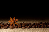 Fototapety Coffee and Star Anise on sackcloth background with copyspace