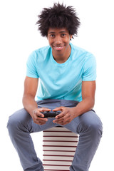 Young black teenage men playing video games - African people