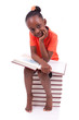 Cute black african american little girl reading a book - African