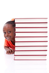 Cute black african american little girl hidden behind a stack of
