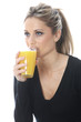 Model Released. Young Woman Drinking Orange Juice