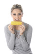 Model Released. Young Woman Eating Corn on the Cob