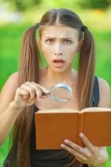 portrait serious beautiful woman magnifier book