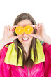 Colorful and fun fitness girl with oranges over her eyes