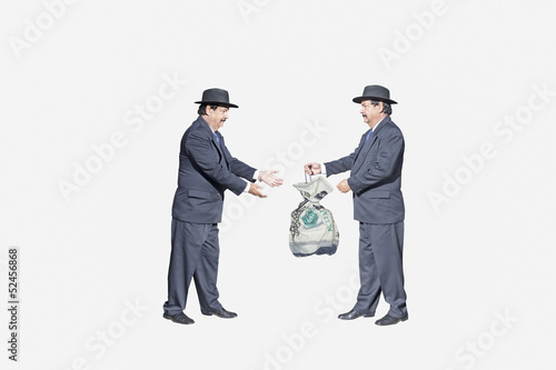 Giving and receiving bribes a crime identical for both
