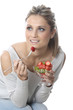 Model Released. Young Woman Eating Fresh Fruit Salad