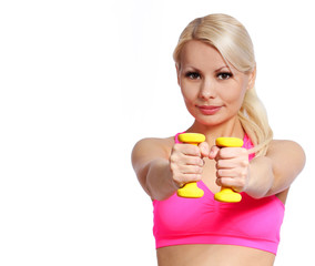fitness girl with dumbbell. happy blonde lifting weights