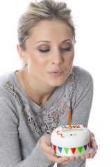 Model Released. Young Woman Holding Birthday Cake
