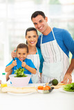 beautiful young family cooking at home