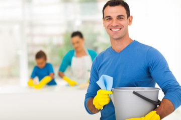 happy family man cleaning home with family