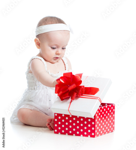 baby girl opening gift box