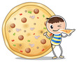 A boy beside a big pizza