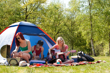 Young teenagers having a nice time on the camping