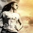 Beautiful woman over sky background