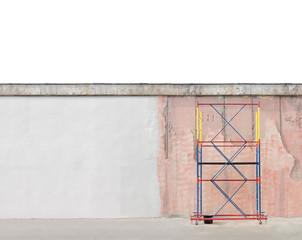 Scaffold next to the wall. Refurbishment