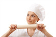 Baker / Chef woman holding baking rolling pin, isolated on white