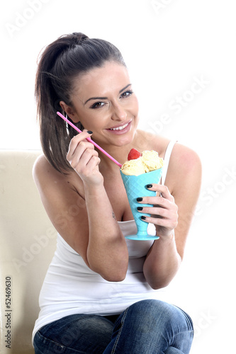 Model Released. Young Woman Eating Vanilla Ice Cream