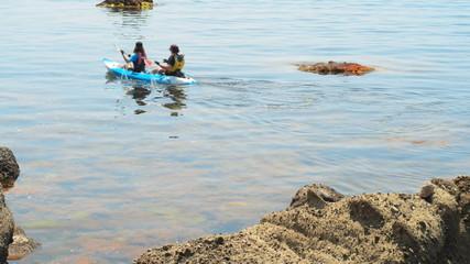 traveler kayaking in the Black sea from backward view