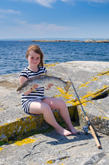 Adorable girl with big silver sea-trout