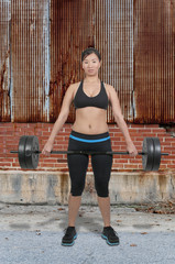 Asian Woman Working with Weights