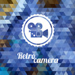 Retro camera on color background made of triangles