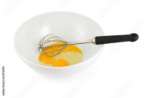Yolk and protein in a bowl with egg beater