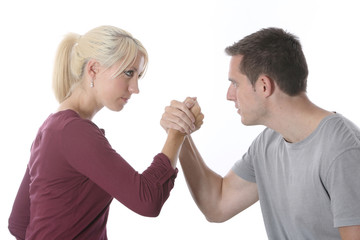 Model Released. Young Couple Arm Wrestling