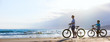 canvas print picture - Mother and son biking at beach