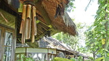 bamboo wind chime at a bungalow in indonesia in wind poster