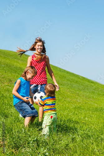 Laughing kids playing with a ball