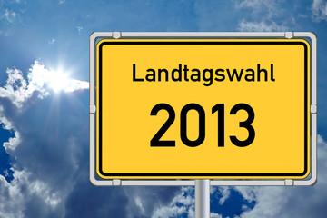 Schild Landtagswahl 2013 vor Himmel