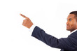 Happy African American businessman pointing at copy space agains