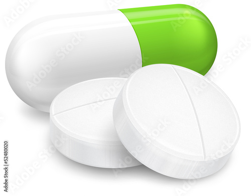 Different pills on white