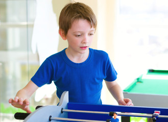 boy playing board football