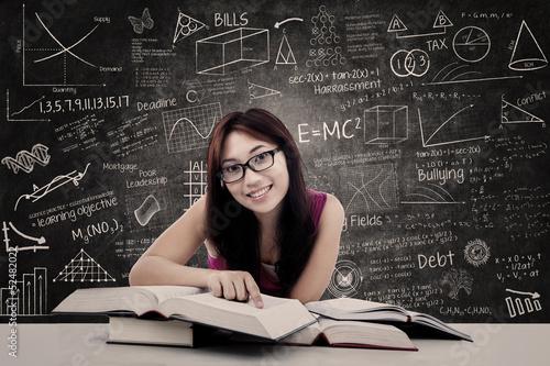 Happy student and written blackboard