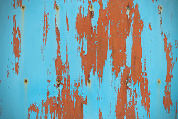 Turquoise board with peeling paint