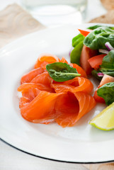 Salted salmon with fresh green salad and lime