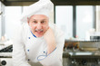 Portrait of a smiling chef in his kitchen