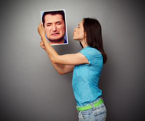 woman kissing the photo of depressed man