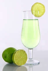 Green cocktail with lime isolated on white